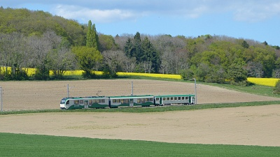 Bière-Apples-Morges train makes its way across the farmland.