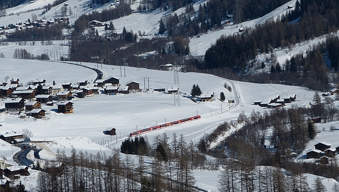 The Gotthard-Matterhorn train (Glacier Express) winds its way along the Rhone River.