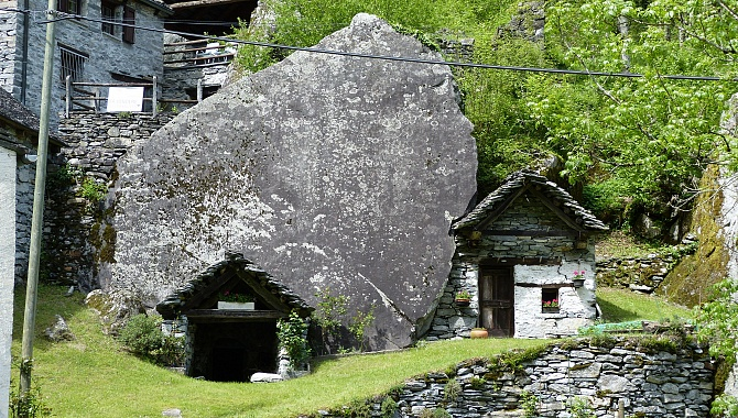 Homes are built into and against the boulders.