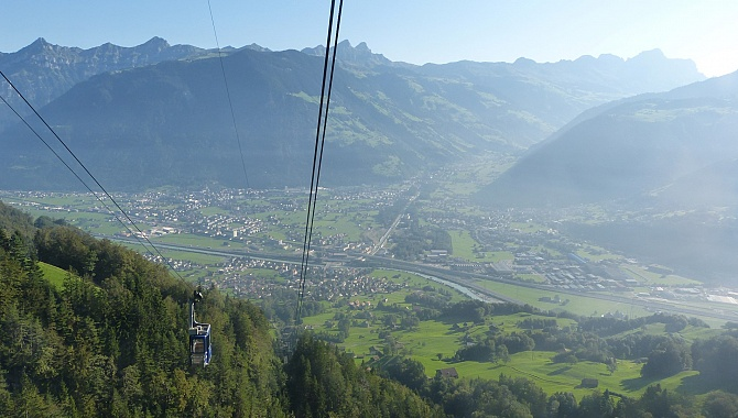 Cable car up from Attinghausen to Brüsti with view into the Schächen Valley.