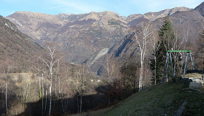 At the back of the Riei Valley, view into the Maggia Valley.