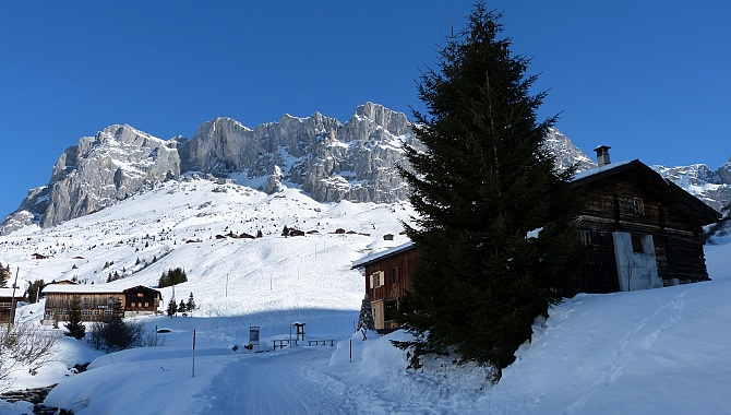 Mount Sulzfluh. The small collection of buildings below the massif is Partnun Stafel