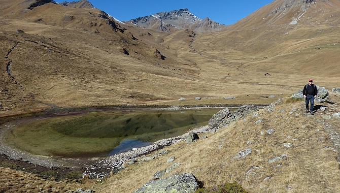 Small lake on the Alpage, in the back is the Torrent Pass to the Val d'Hérens to the West