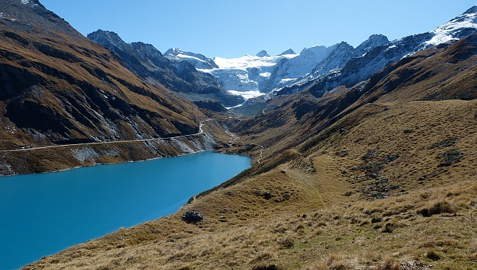 Descending back to the lake with view of the Moiry Glacier at the back.