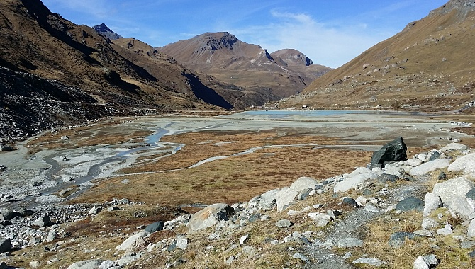 Returning from the glacier, the rivers meander from the glacier to the Moiry Lake