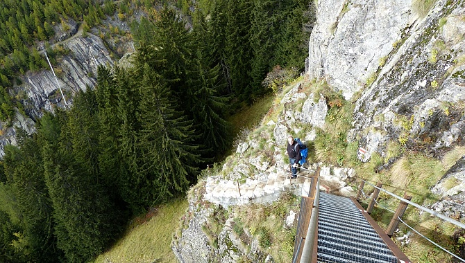 The first part of the descent is steps and stairs along the cliff face. The second part is through the forest.