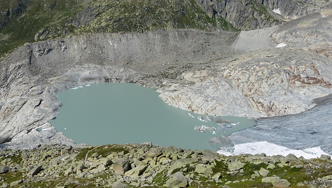 Tongue of glacier and glacier lake. This basin was full of ice not 30 years ago